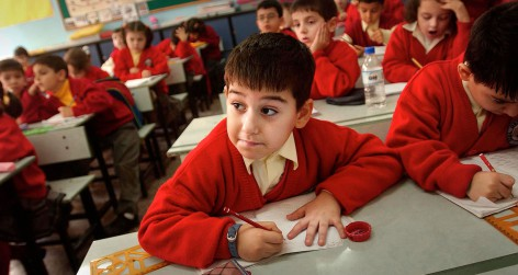 A six-year-old Kurdish boy, watches a lesson given in Turkish (Photo by Chris Hondros/Getty Images)