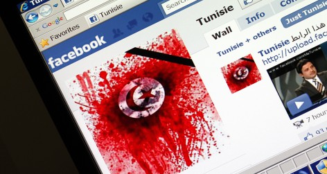 A student-run facebook page shows an image depicting the Tunisian national flag smeared in red on a computer screen in Paris