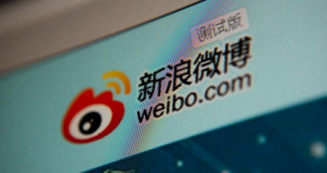 The Sina Corp weibo microblog website is displayed on a computer in Beijing, China. (Photographer: Nelson Ching/Bloomberg via Getty Images.)