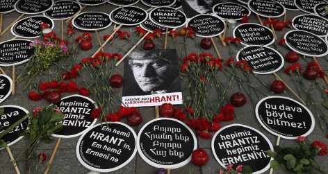 Carnations and placards are placed on the spot outside the Agos newspaper building during a commemoration to mark Dink's fifth death anniversary in Istanbul