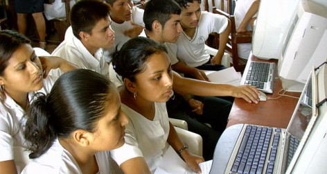 Students learning to use a computer
