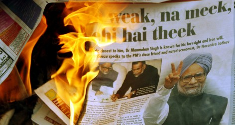 Burning newspaper (Photo by Punit Paranjpe / Reuters)