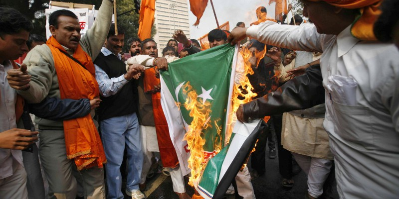 Supporters of Shiv Sena burn Pakistan's national flag during a protest in New Delhi