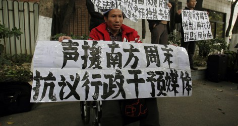 A supporter of Southern Weekly in a wheelchair demonstrates outside the office of the liberal newspaper in the southern Chinese city of Guangzhou