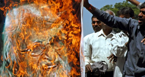 Indian activists from a hardline Hindu group burn a poster of Indian artist Husain during a protest in Bangalore