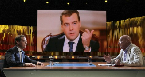 "Russia's Prime Minister Dmitry Medvedev speaks with Channel One Russia TV presenter Vladimir Pozner during the ""Pozner"" program in Moscow"