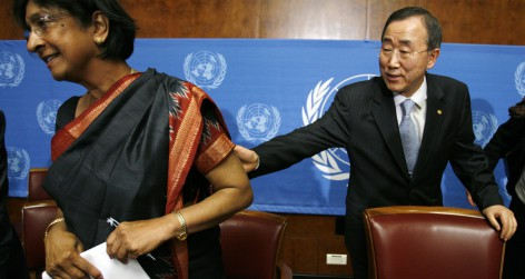 U.N. Secretary-General Ban reaches for U.N. High Commissioner for Human Rights Pillay after a news conference after the first day of the Durban Review Conference on racism at the U.N. in Geneva
