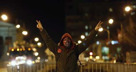 A protester marches through the streets as he demonstrates against what they say is police brutality after the Ferguson shooting of Michael Brown, an unarmed black teenager, by a white police officer, in St. Louis, Missouri